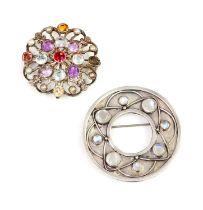 A silver Arts & Crafts moonstone circle brooch,