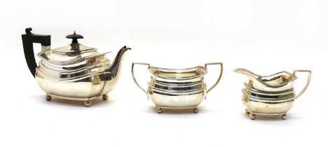 A silver three piece tea service,