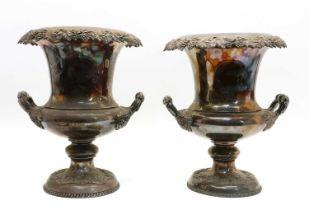 A pair of silver-plated campana shaped urns