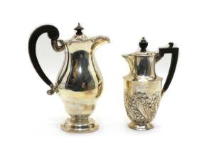 An Edwardian silver hot water pot,