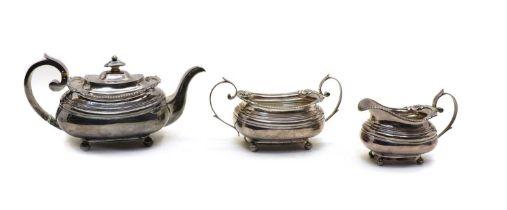A George III silver three piece teaset,