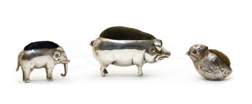 A novelty silver pin cushion in the form of a pig,