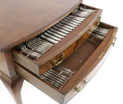 A Chippendale style walnut canteen of silver flatware,