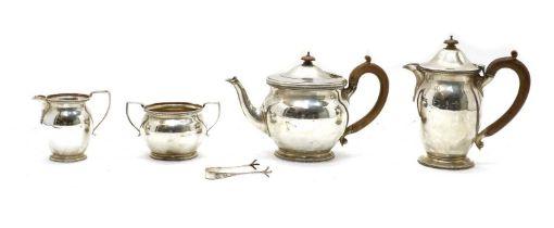 A silver four piece tea service