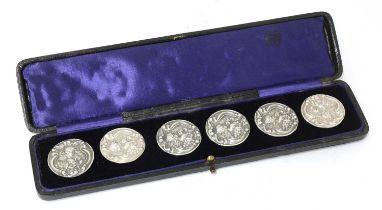 A cased set of six Art Nouveau silver buttons,
