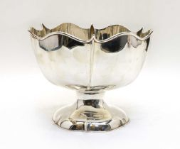 A footed silver bowl,
