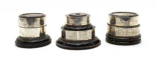 Three ebonised trophy stands,
