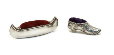 A novelty silver pin cushion in the form of a canoe,