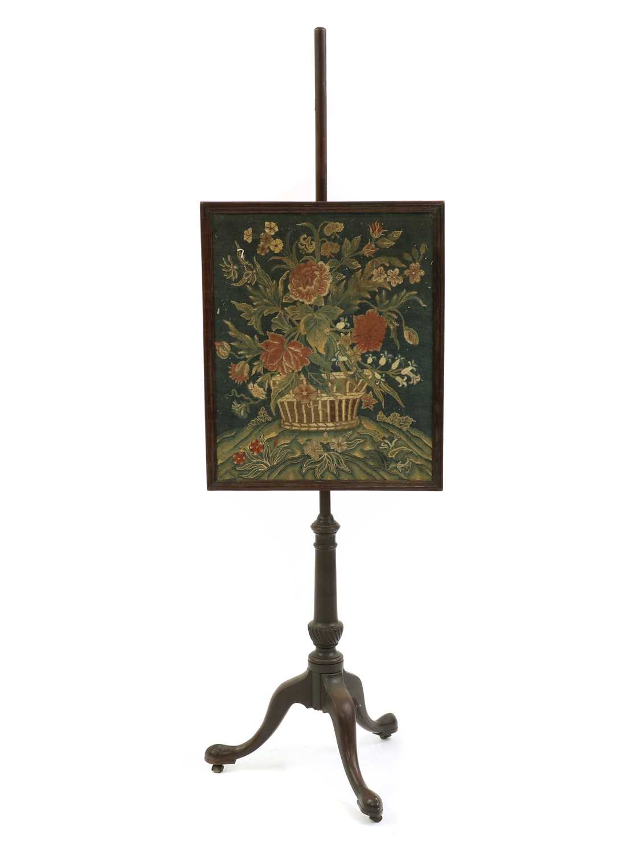 A Victorian mahogany pole screen