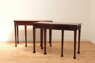 A pair of mahogany console tables,