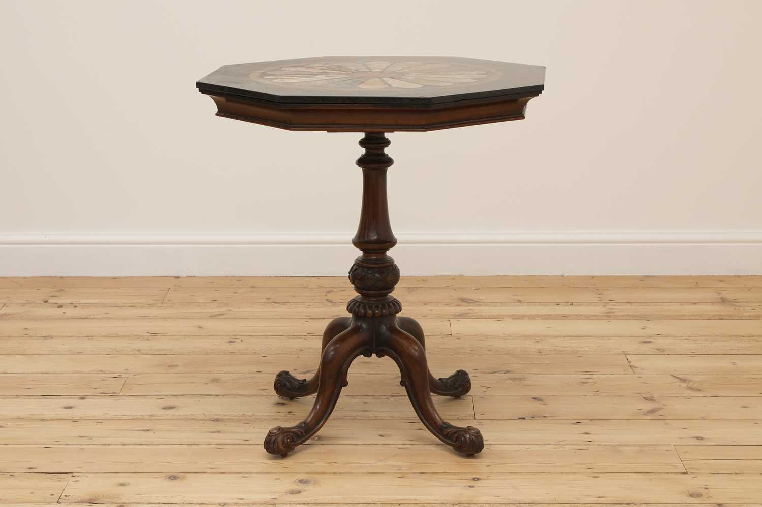 An octagonal walnut and specimen marble-topped table,