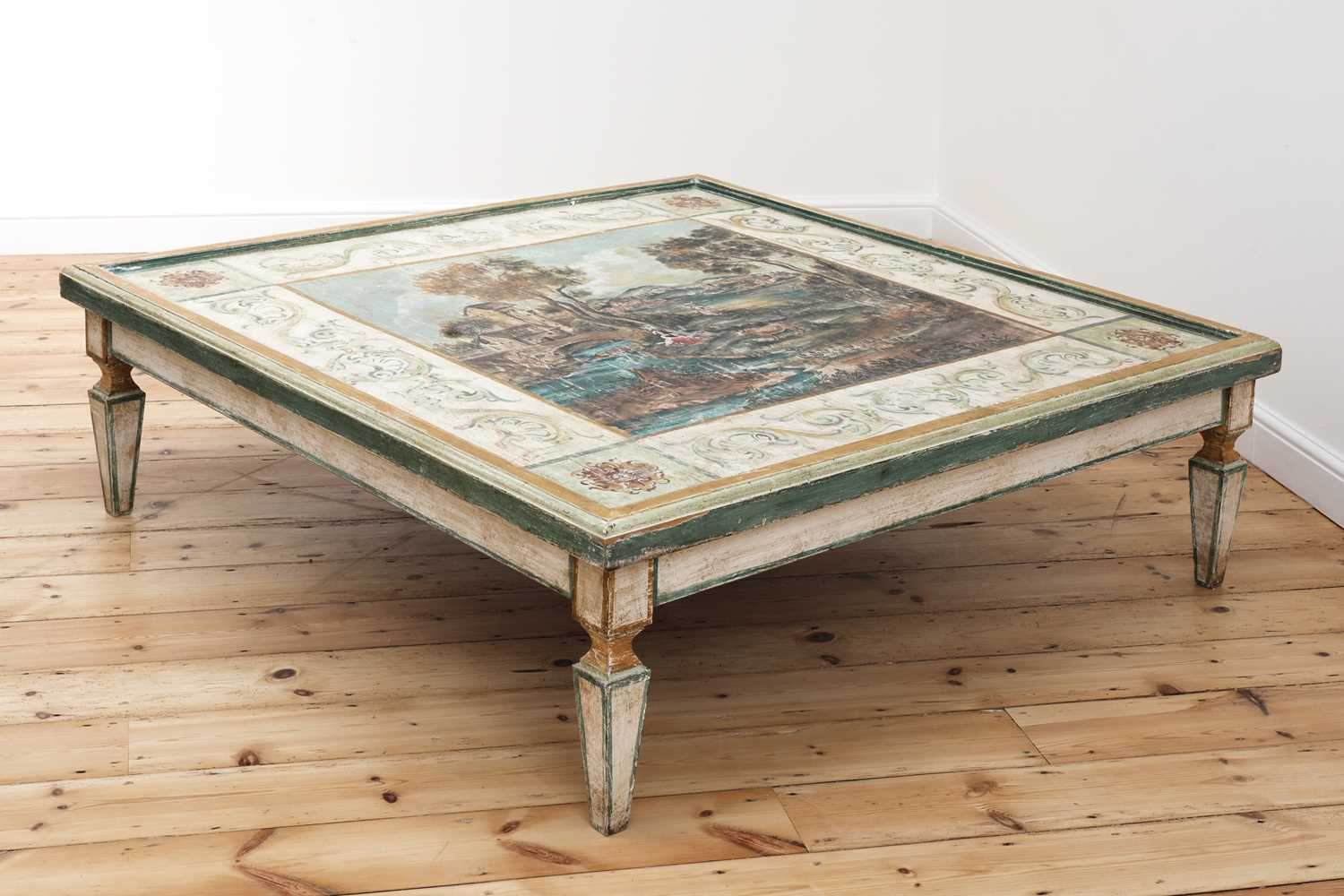 A large Continental painted wood coffee table,