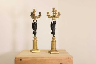A pair of French Empire ormolu and bronze candelabra,
