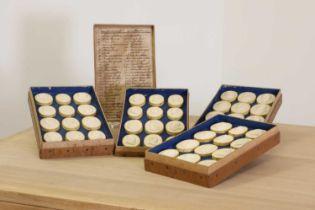 A box of grand tour plaster intaglios,