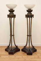 A pair of carved and painted torchères,