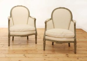 A pair of French Louis XVI-style painted fauteuils,