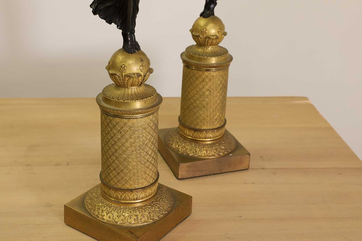 A pair of French Empire ormolu and bronze candelabra, - Image 6 of 30