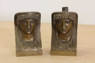 A pair of Egyptian-style bronze furniture mounts,