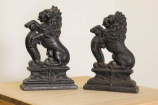 A matched pair of cast iron doorstops,