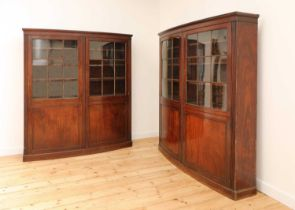 A pair of mahogany bow front bookcases,
