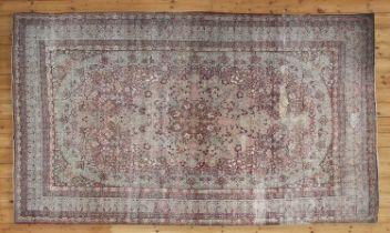 A rare antique Persian Laver carpet,