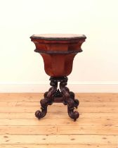 A Victorian flame mahogany teapoy by Gillows of Lancaster,