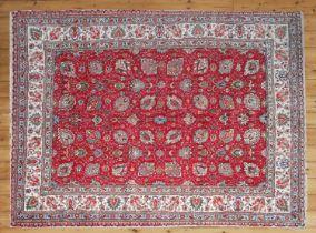 A Persian wool carpet,