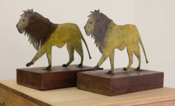 A pair of painted folk art lions,