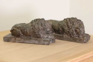 A pair of cast lead lions after Antonio Canova,
