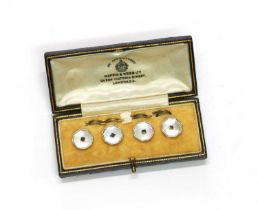 A cased set of four gold sapphire and mother-of-pearl buttons,