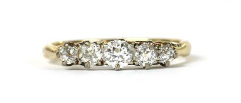 A gold five stone diamond ring,
