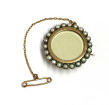 A gold and silver, split pearl set brooch,