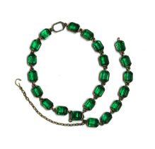 A silver two row green paste bracelet,