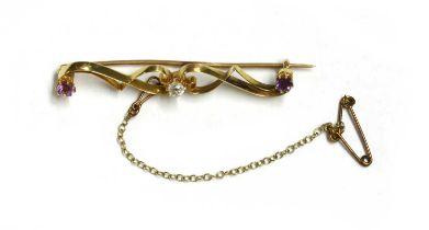 A gold diamond and amethyst brooch,