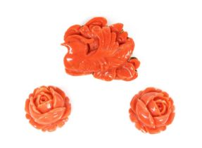 An Asian carved coral plaque brooch,