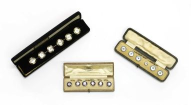 Three sets of buttons,