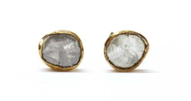 A pair of gold foil-backed diamond stud earrings,
