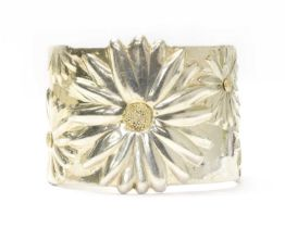 A silver daisy torque cuff bangle, by Tiffany & Co.,