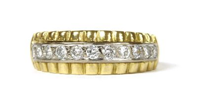 A gold diamond half eternity ring,