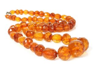 A single row faceted cognac amber bead necklace,