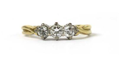 An 18ct gold three stone diamond ring,