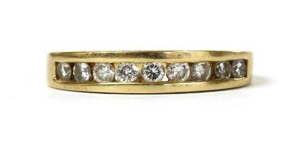 An 18ct gold diamond half eternity ring,