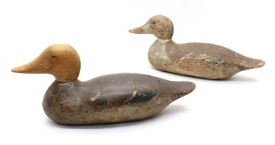 Two carved wood and painted duck decoys,