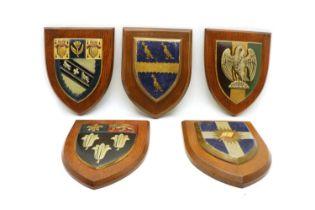 A collection of twelve heraldic plaques,