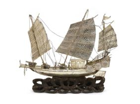 A Chinese export white metal model of a junk,