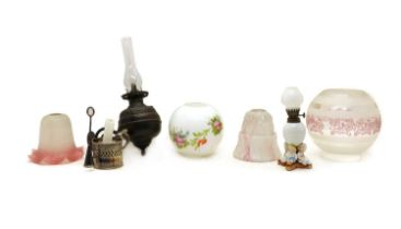 A box of oil lamps and glass shades