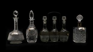 A set of three cut-glass decanters,