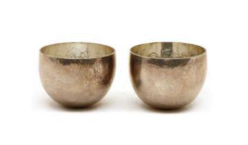 A pair of Britannia silver tumbler cups,