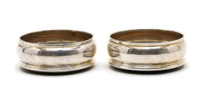 A pair of silver coasters,