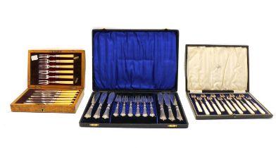 A cased set of twelve Continental silver hors d'ourves forks,